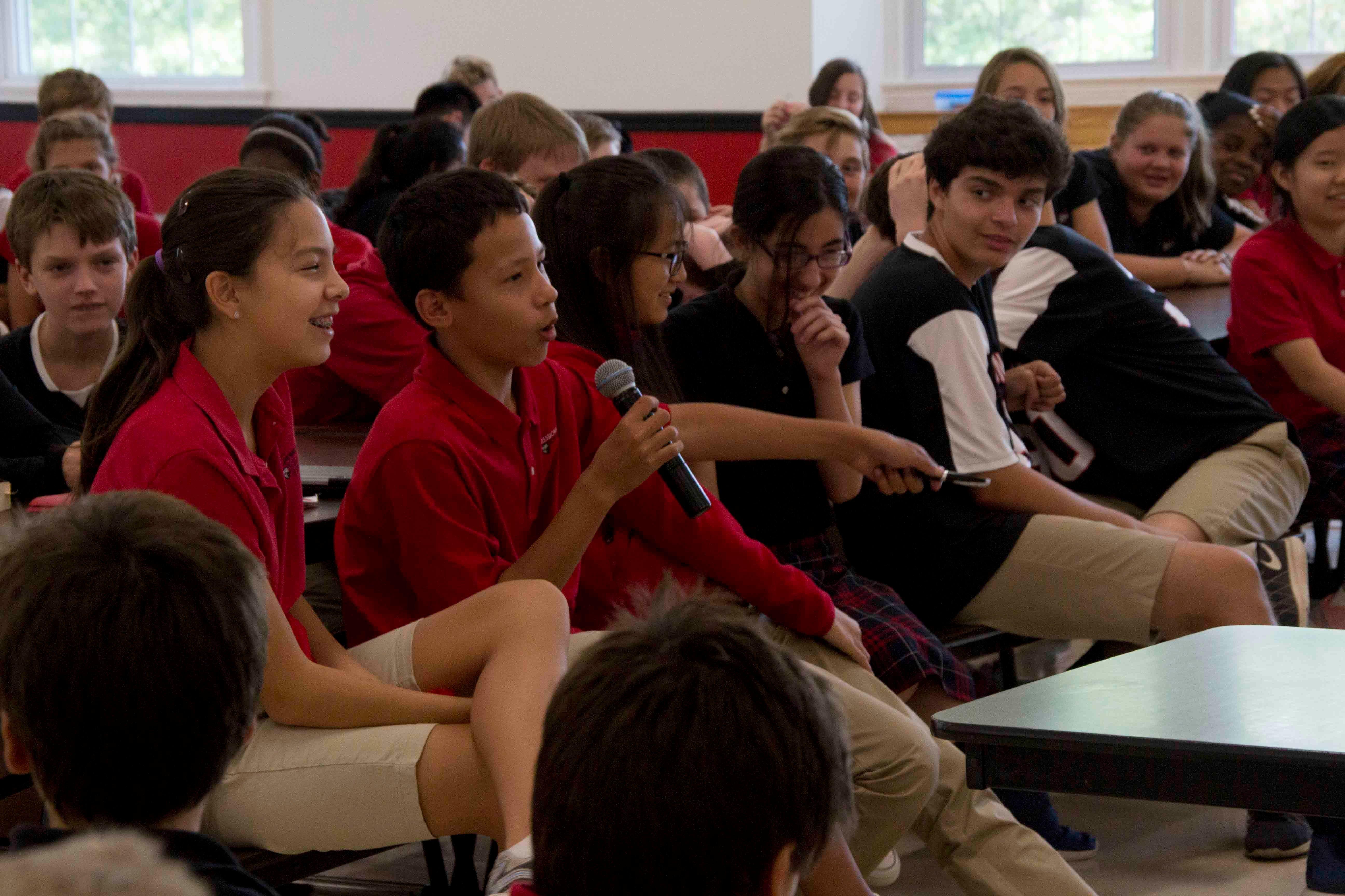student speaking microphone