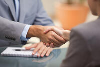 Two Businesspeople shaking hands indoors-1