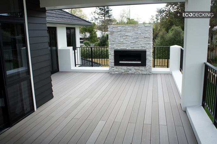 Outdoor fireplace with decks for Grey decking garden ideas
