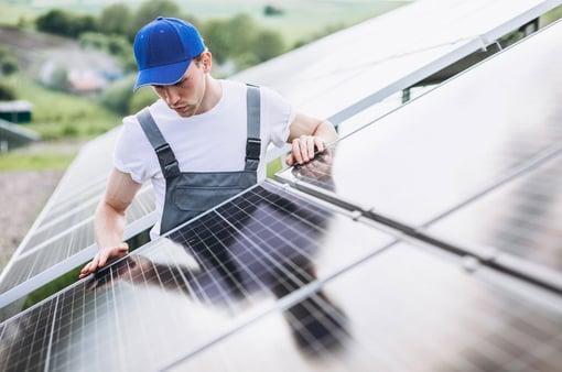 man installing solar panel