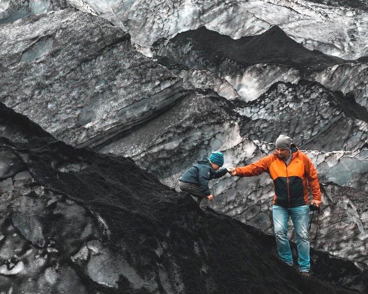 Man and child climbing on rocks