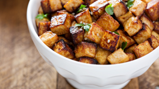 Roasted Brussels Sprouts and Tofu with Ginger-Sesame Maple Balsamic Sauce