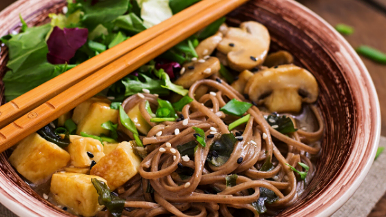 Japanese Udon Noodles with Tofu and Mushrooms topped with Veggies
