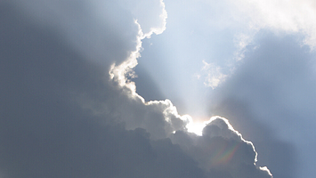 Silver lining of the clouds with sunlight shining behind