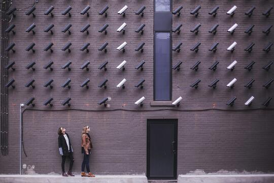 two-person-standing-under-lot-of-bullet-cctv-camera-374103