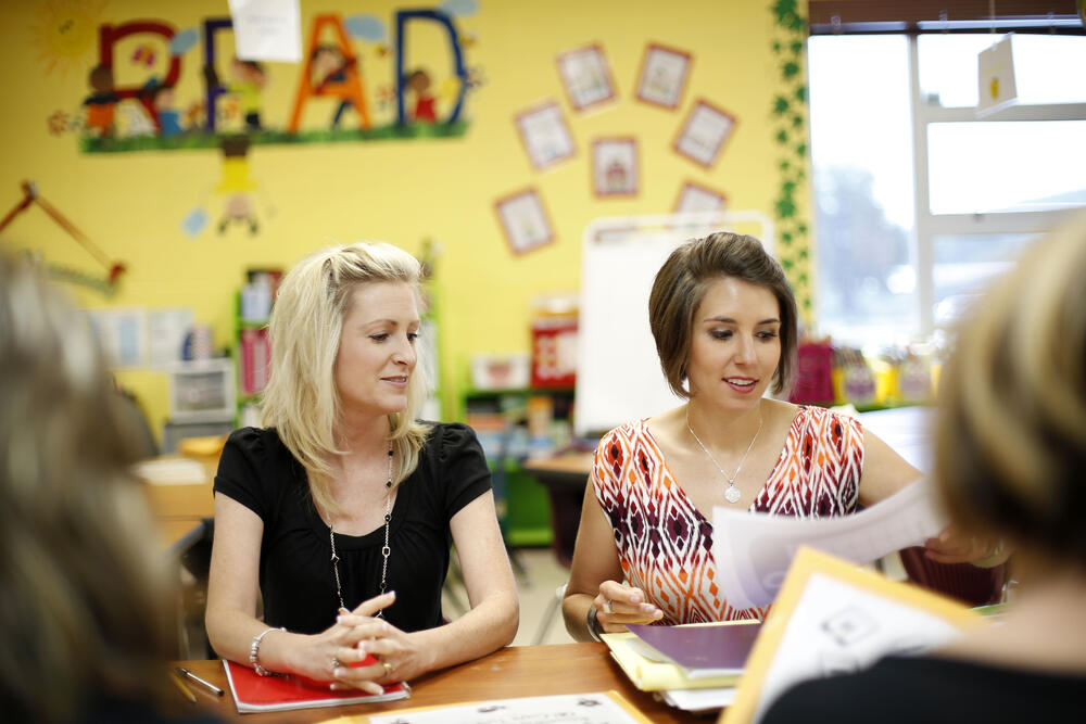 Two teachers reviewing student work together