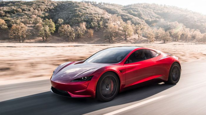Tesla Roadster red driving fast