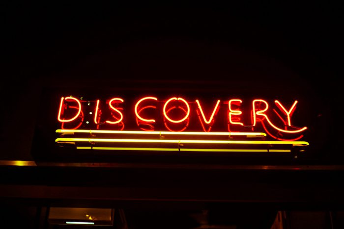 Discovery red yellow neon sign