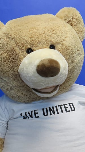 Mr. LIVE UNITED Bear Mascot