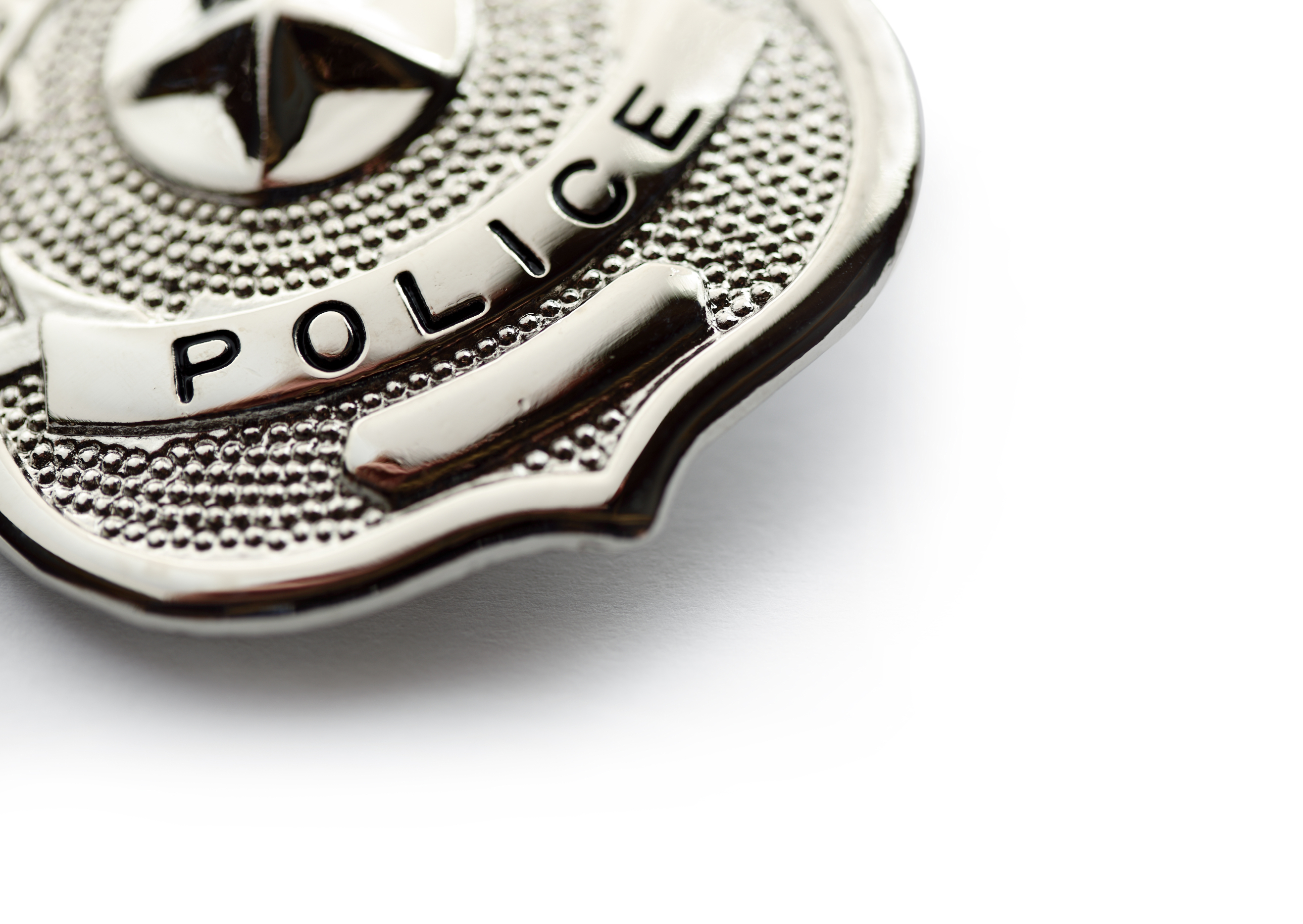 Badge in an Article About Community Policing and the COPS Grant