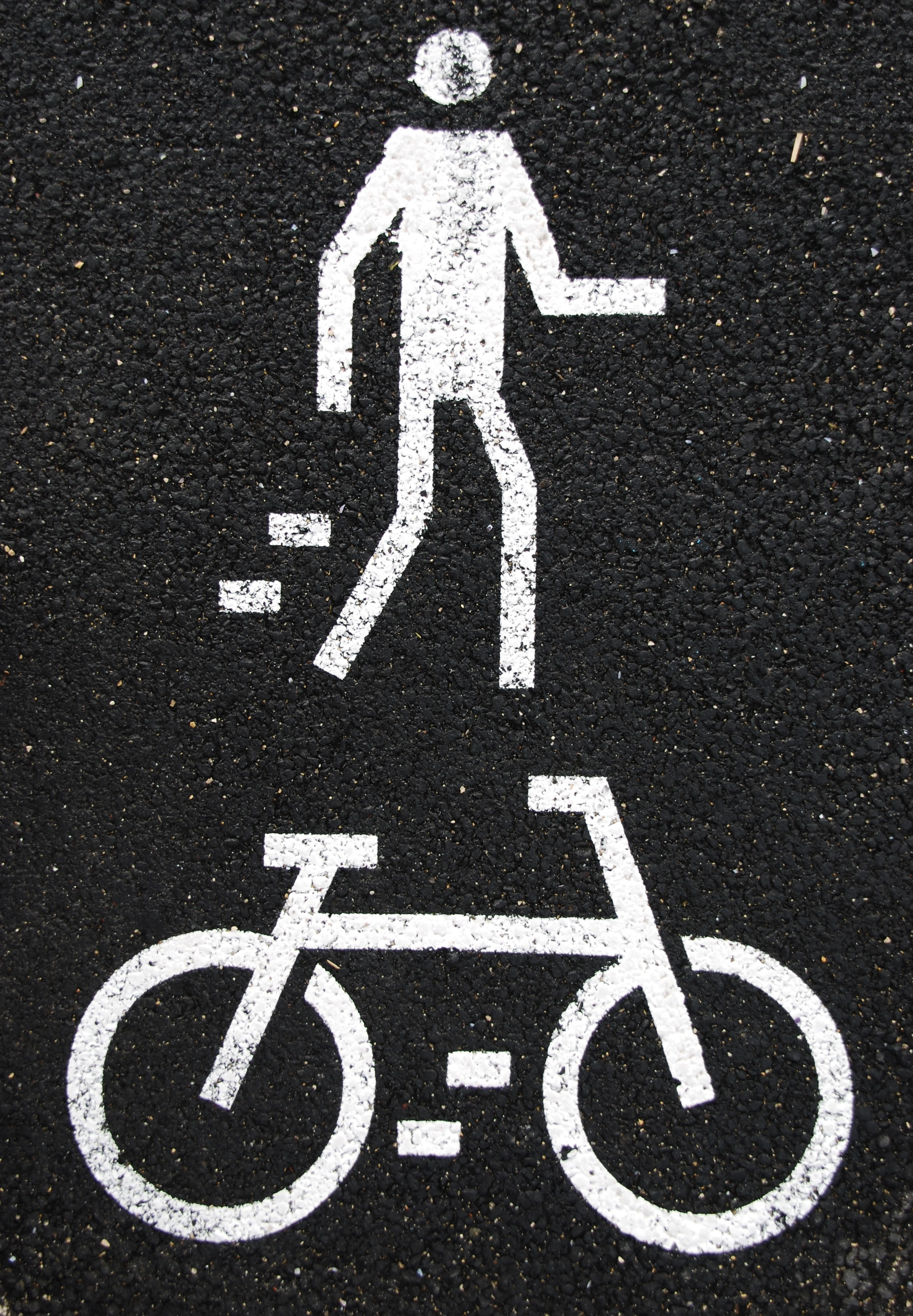 Pedestrian and Bicycle Sign in an Article About Complete Streets