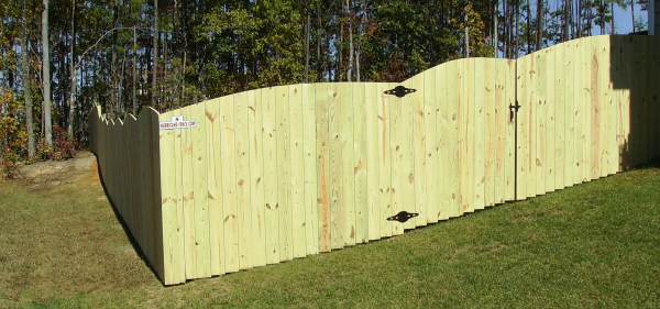 putting up a privacy fence on a hill 2