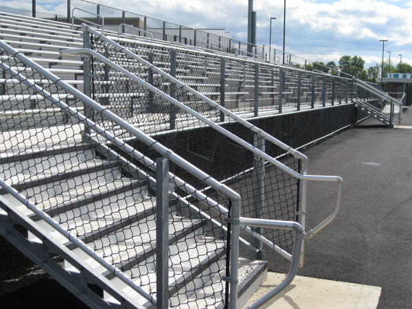 Bright Steel tubing with bleachers and black chain link mesh encloses a track in Glen Allen.
