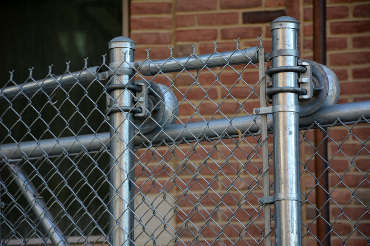 Chain link security fence installed by Hurricane Fence Company Norfolk