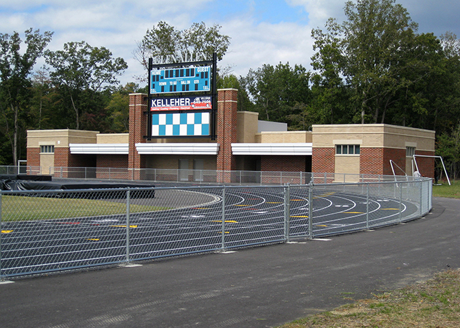 A commercial steel chain link fence enclosure rounds out a community track in Glen Allen, VA