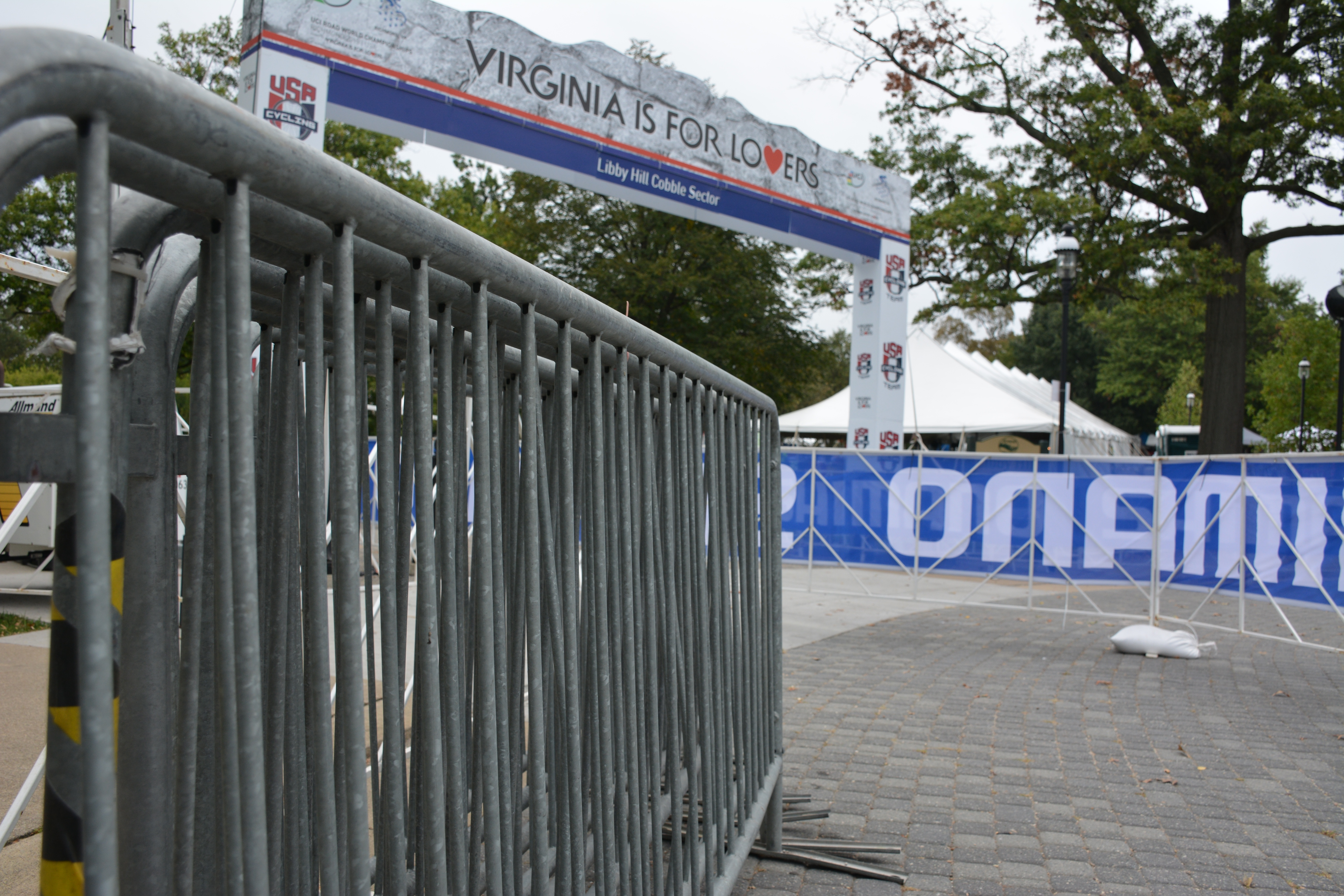 A Virginia is for Lovers arch lines the Libby Hill cobblestone UCI race track with temporary barricades from Hurricane Fence Company