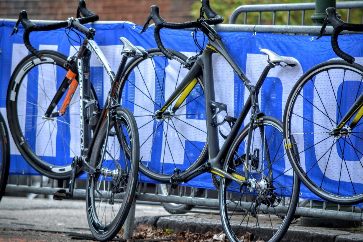 Road bikes rest on a Shimano banner covered Barricade from Hurricane Fence Company at the final day of Richmond 2015 race.