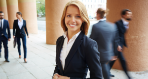 women in a business suit smiling