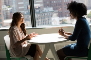 two women interviewing