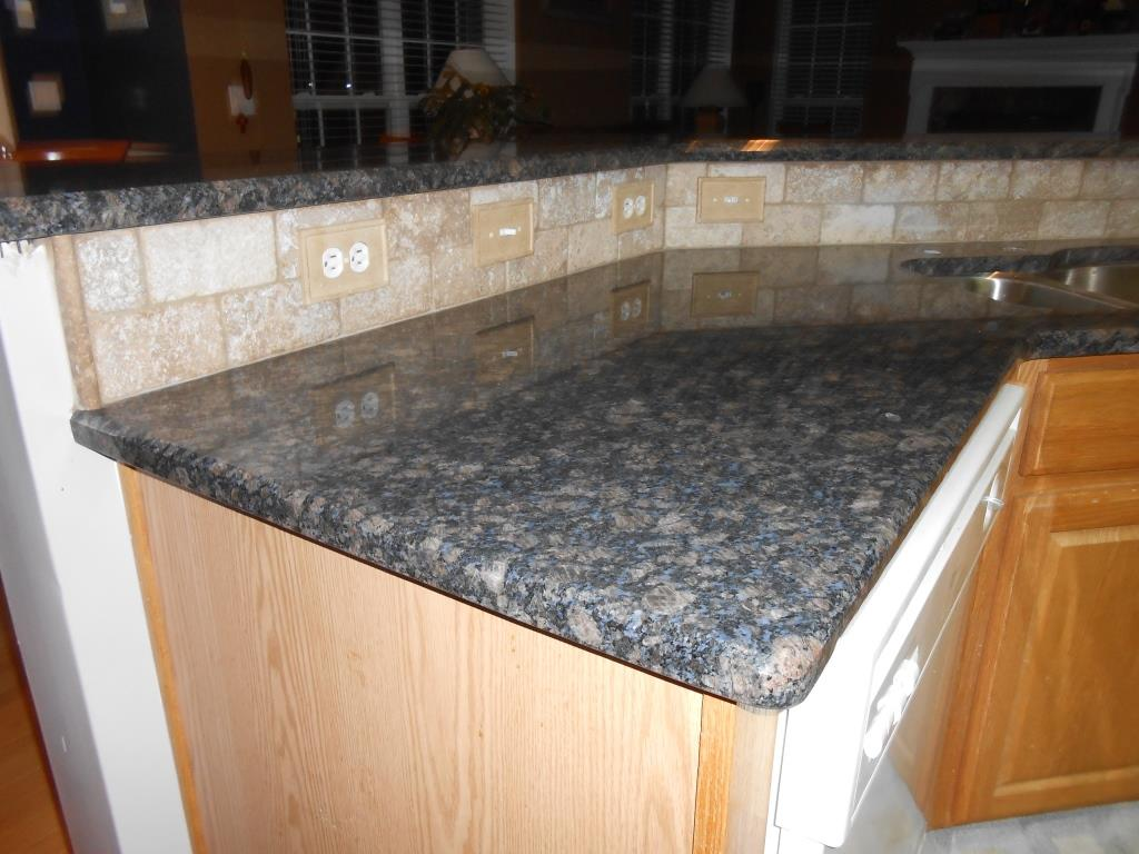Sapphire Blue Granite With 3x6 Walnut Travertine Tile