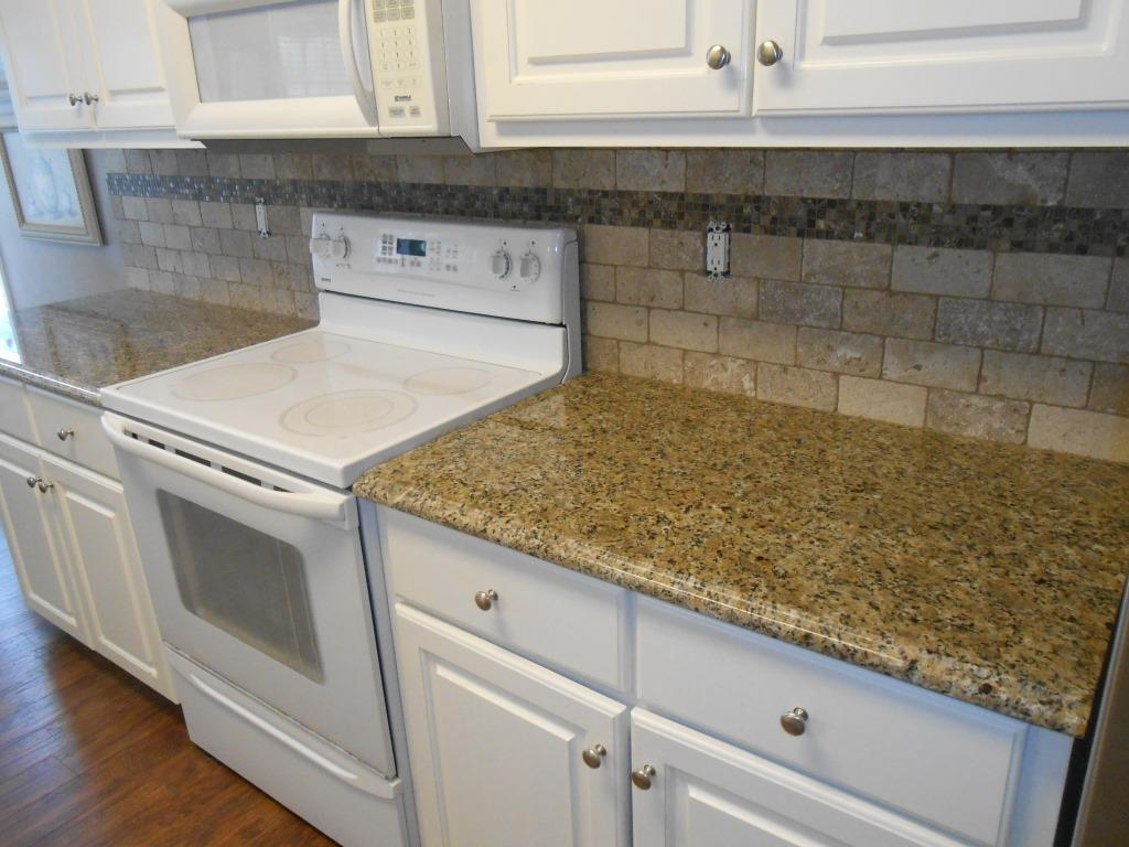 new venetian gold granite with white cabinets pictures everd