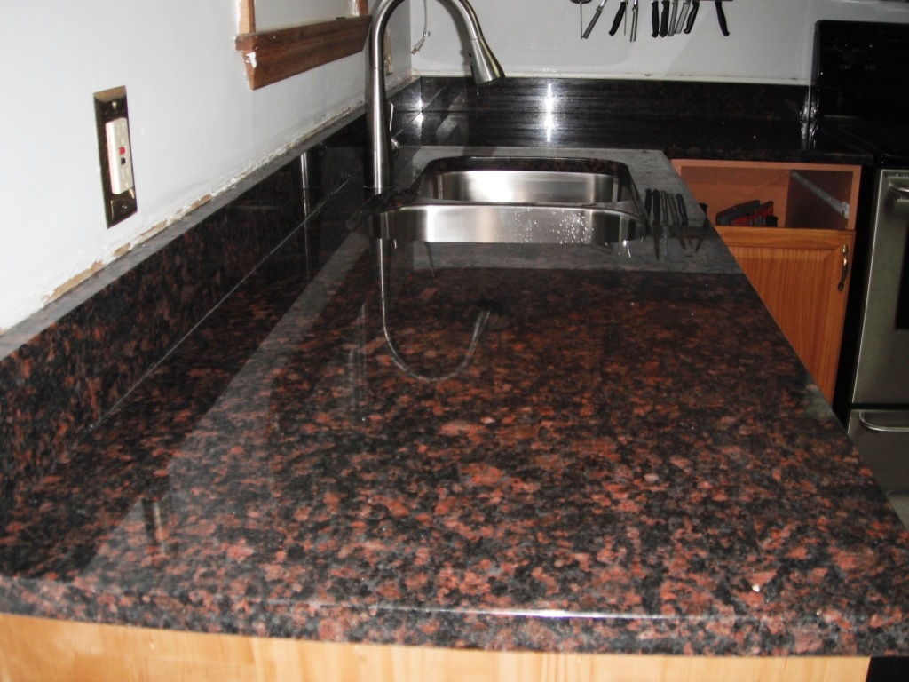 Granite colors charlotte tan brown granite for Granite countertops colors price