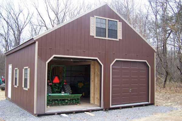 aframe 2 story storage shed with 2 garage doors