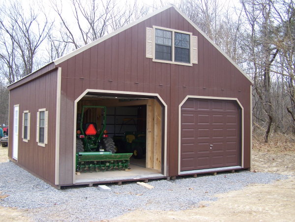 Protect your equipment from april showers with a storage for Two story prefab garages