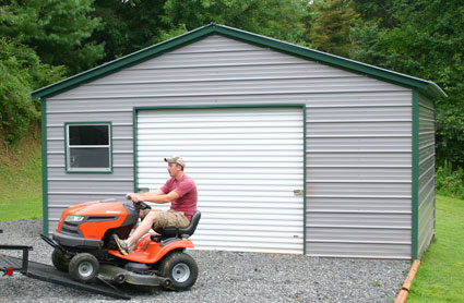 Protect your riding mower with a storage shed or garage for Garden shed for lawn mower