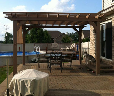 wood pergola kit on brick patio