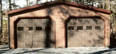 modular two car garage with custom vinyl siding