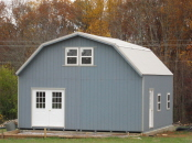 two story barn building with house double doors