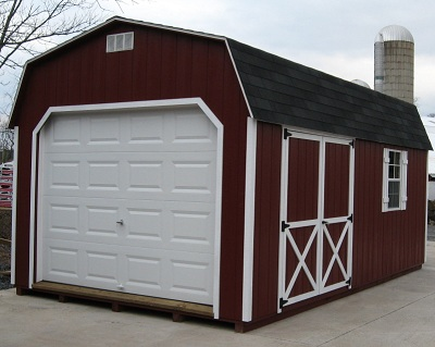 A maroon 12x24 barn-style wooden garage with white trim