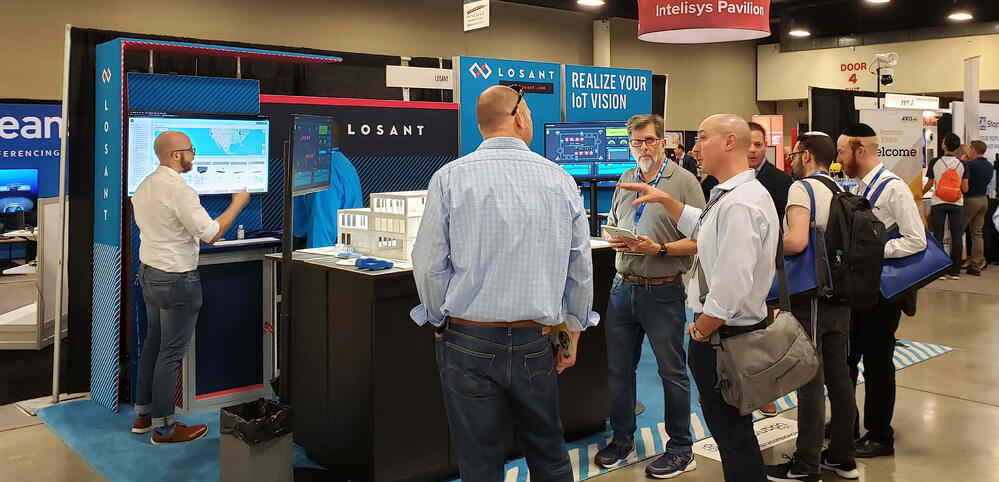 People at the Losant booth at IoT Evolution