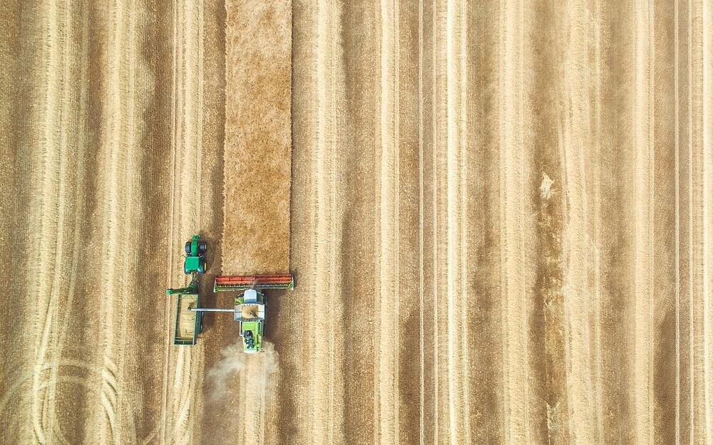 Shows harvesting equipment being used for asset-tracking in IoT for Agriculture.