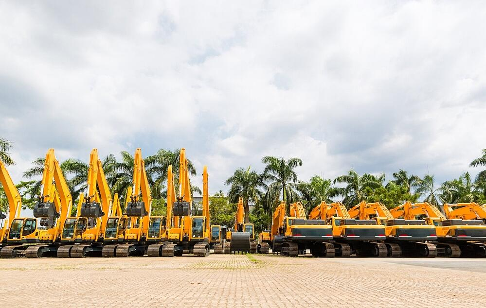 Several diggers and bucket loaders ready to be dispatched.