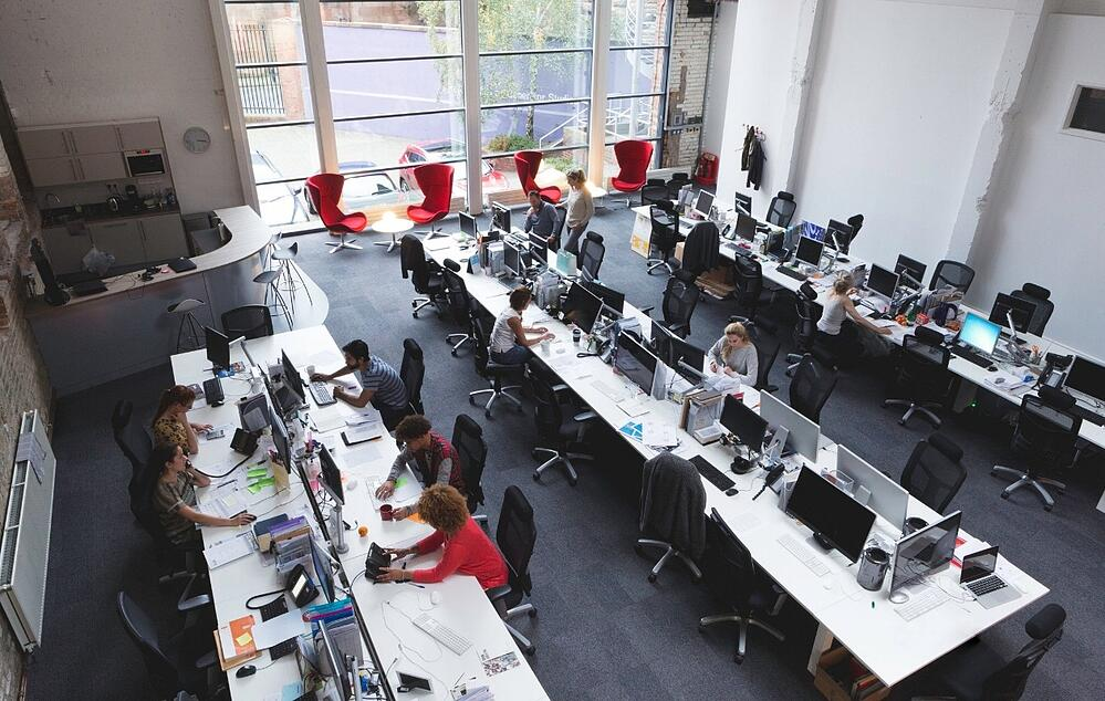 A smart office environment with people, furniture and expensive computer assets that can be tracked easily with IoT.