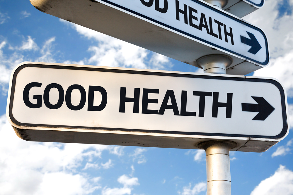 Good Health direction sign on sky background