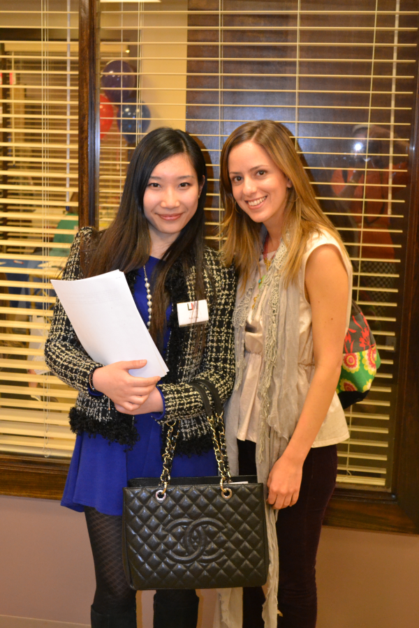 MBA students from China and Venezuela pose at our fashion industry career fair.