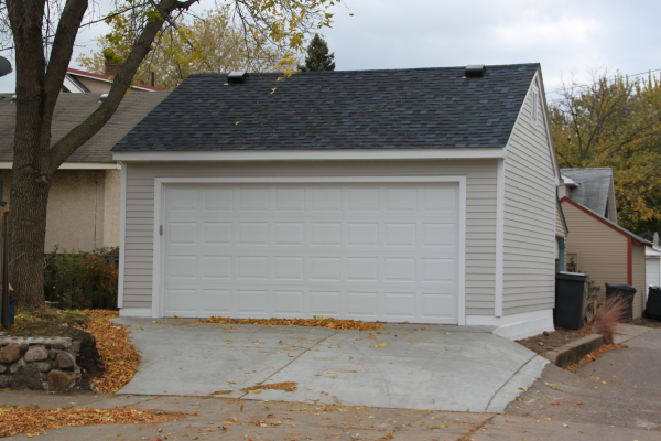 2 car garage gable roof style vs reverse gable roof style for Gable roof garage