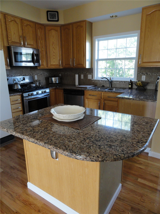 the curved island countertop maximizes the food prep area a new stainless steel sink with