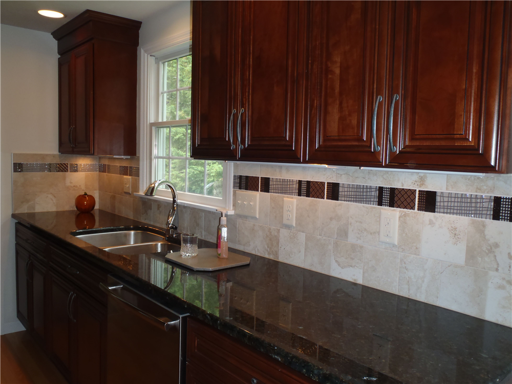 Recessed And Undercabinet Lights Provide Task Lighting On The Counter Areas Backsplash Field Tiles Are