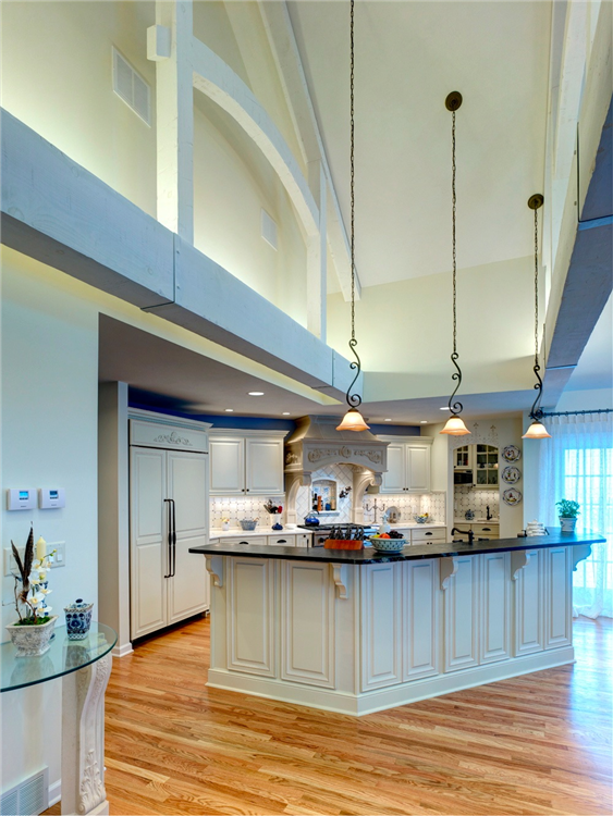 Among the outstanding features of this kitchen are its 15' high cathedral ceiling and hand hewn interior trusses spanning the 24' width of the room. There are many options for lighting including recessed, pendants and under-cabinet. Hidden uplights on the top of the wood beams light the cathedral ceiling.