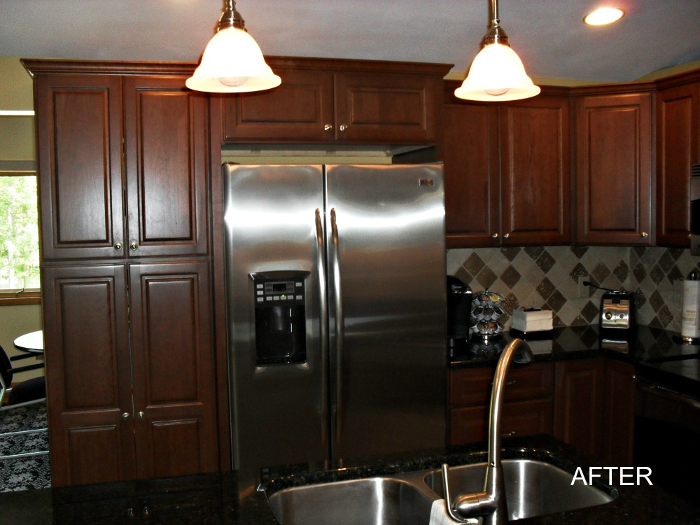 a divider wall was removed to create space for a tall kitchen cabinet to provide pantry