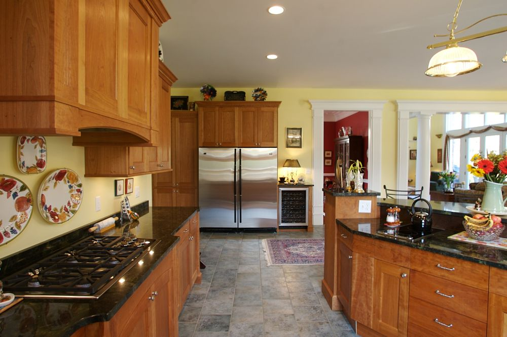 Kitchen a warm rich feel the kitchen opens to a sitting area and