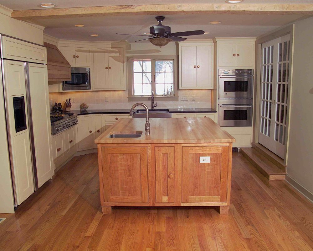 and dishwasher. The island includes a butcher-block countertop ...