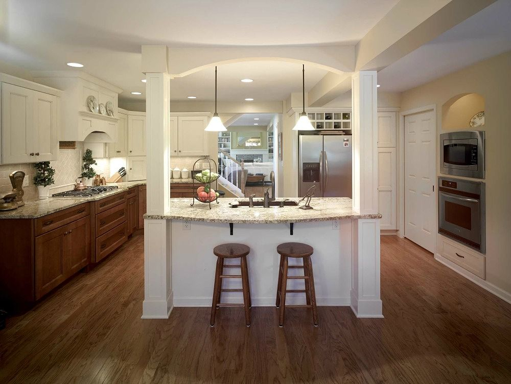 This Exquisite Kitchen Features An Island With Two Paneled Posts And Pendant Lighting For Food Prep