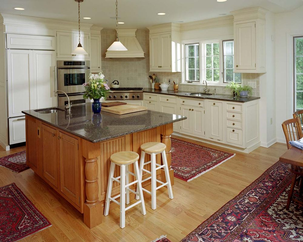 this kitchen blends modern elements such as the builtin with an