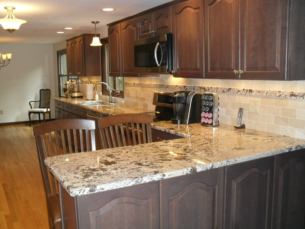 granite tiles were used as an accent strip to tie the new backsplash into the granite kitchen counter remodel syracuse cny   small kitchen construction  rh   mcclurgteam com