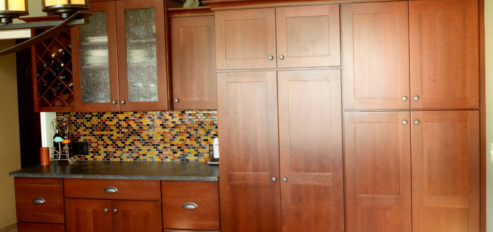 Cherry Cabinets Are Used For A Beverage Center And Tall Pantry Storage. The  Perimeter Cabinets
